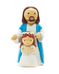 First Communion girl with Jesus Statue